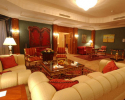 Presidential Suite has a bedroom, sitting room, kitchenette and meeting room